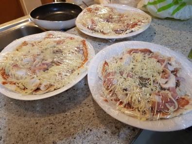 Many pizzas ready to freeze